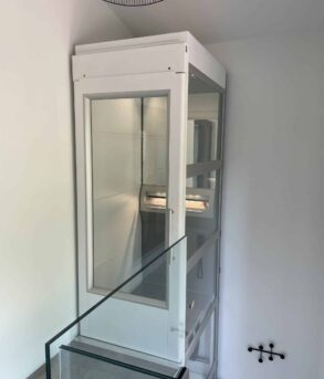 Glass box elevator with thick door frame